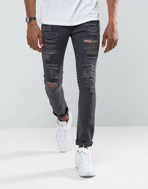 ASOS Выбеленные черные супероблегающие джинсы с рваной отделкой. Цвет: черный