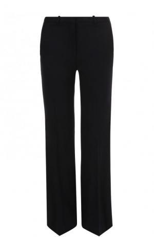 Однотонные расклешенные брюки из шерсти со стрелками Theory. Цвет: темно-синий