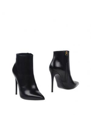 Полусапоги и высокие ботинки GIANMARCO LORENZI. Цвет: черный