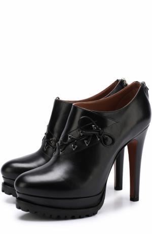 Кожаные ботильоны на шнуровке Alaia. Цвет: черный
