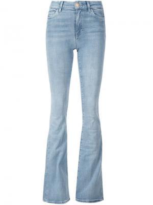 Расклешенные джинсы Mih Jeans. Цвет: синий