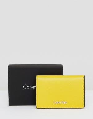 Calvin Klein Визитница. Цвет: желтый