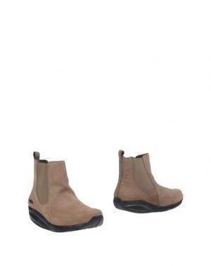 Полусапоги и высокие ботинки MBT. Цвет: хаки