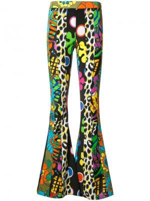 Расклешенные брюки с психоделическим принтом Moschino. Цвет: многоцветный