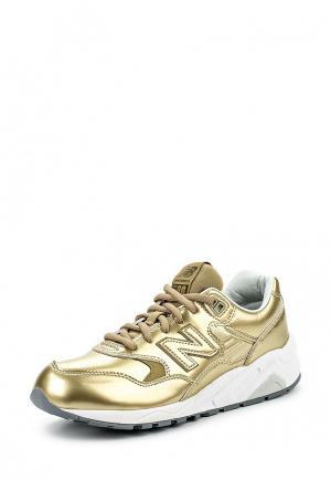 Кроссовки New Balance. Цвет: золотой