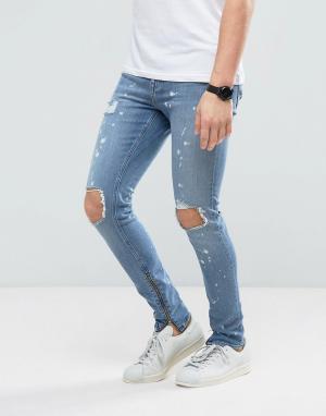 New Look Супероблегающие джинсы с рваной отделкой, молниями по бокам и эффектом. Цвет: синий