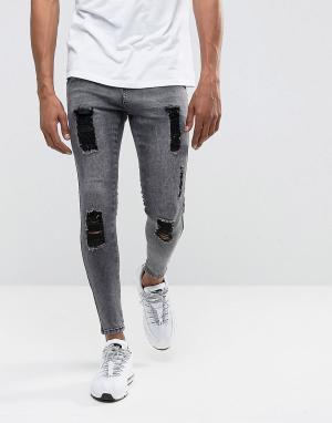 Illusive London Черные джинсы скинни с эффектом кислотной стирки и рваной отделкой Ill. Цвет: черный