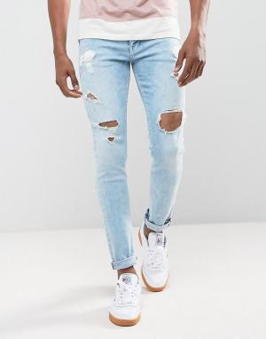 ASOS Светло-синие джинсы скинни с рваной отделкой. Цвет: синий