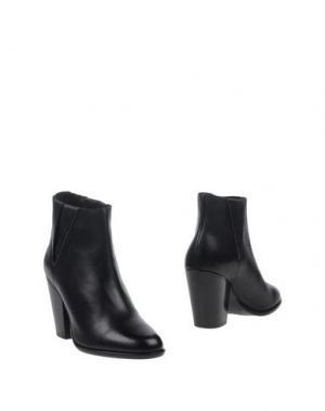 Полусапоги и высокие ботинки BOEMOS. Цвет: черный