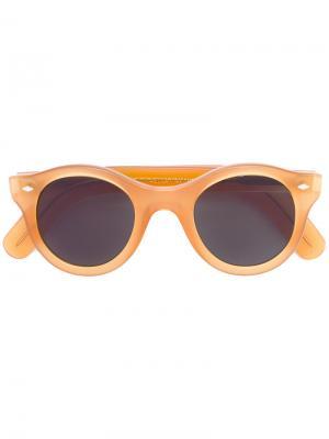 Солнцезащитные очки в круглой оправе Cutler & Gross. Цвет: жёлтый и оранжевый