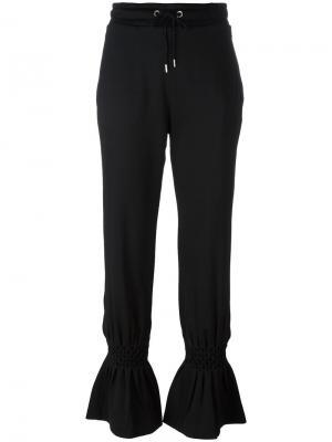Спортивные брюки клеш Kenzo. Цвет: чёрный