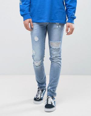 ASOS Светлые рваные джинсы скинни. Цвет: синий