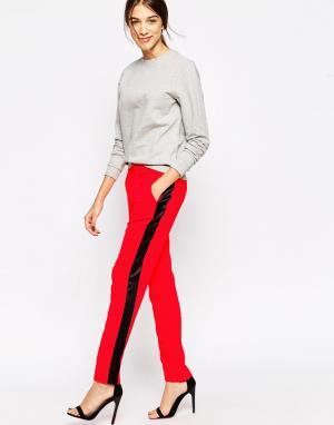 American Retro Оранжевые брюки с контрастными черными полосками. Цвет: оранжевый