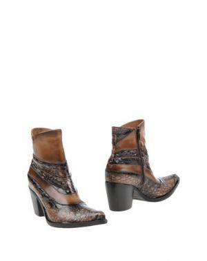 Полусапоги и высокие ботинки DONNA PIÙ. Цвет: хаки