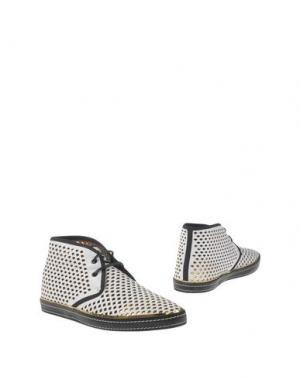 Полусапоги и высокие ботинки SERGIO ROSSI. Цвет: белый