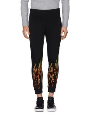 Повседневные брюки OMC. Цвет: черный