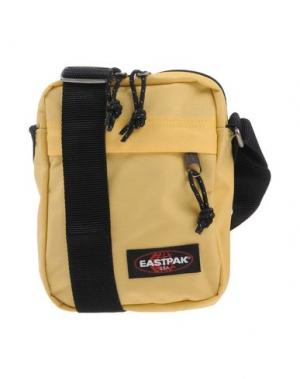 Сумка через плечо EASTPAK. Цвет: желтый
