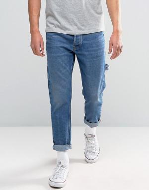Tommy Jeans Темно-выбеленные суженные книзу джинсы 90S Carpenter M18. Цвет: синий