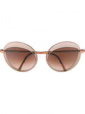 Объемные солнцезащитные очки в круглой оправе Lindberg. Цвет: коричневый