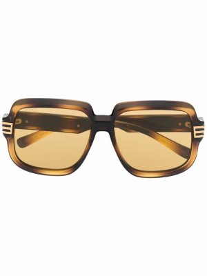 Солнцезащитные очки в оправе черепаховой расцветки Gucci Eyewear. Цвет: коричневый