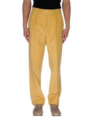 Повседневные брюки GERANI. Цвет: желтый