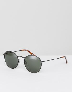 Черные круглые солнцезащитные очки Levis. Цвет: черный