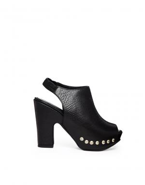 Кожаные туфли на каблуке с ремешком через пятку Gardenia. Цвет: bufalo black
