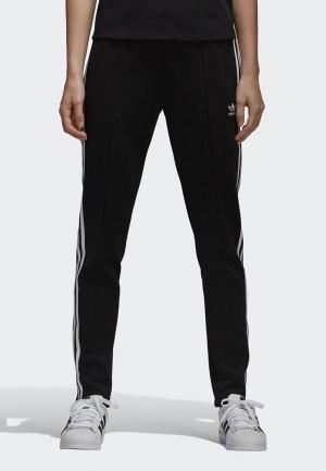 Брюки спортивные adidas Originals SST TP. Цвет: черный