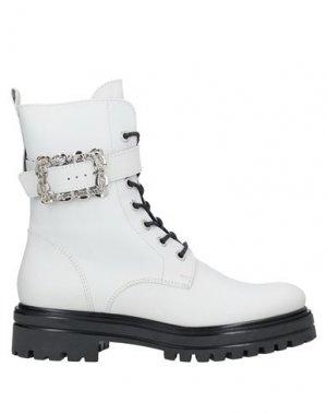 Полусапоги и высокие ботинки GUGLIELMO ROTTA. Цвет: белый