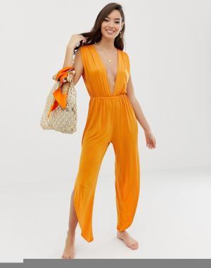 386f397ffd35958 Трикотажный пляжный комбинезон выгоревшего оранжевого цвета с глубоким  вырезом и разрезами ASOS DESIGN. Цвет: