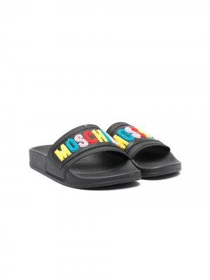 Шлепанцы с вышитым логотипом Moschino Kids. Цвет: черный