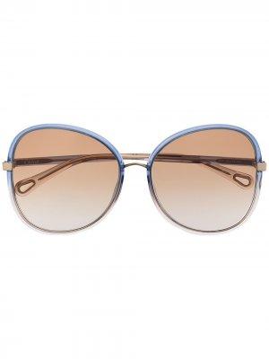Солнцезащитные очки в массивной оправе Chloé Eyewear. Цвет: синий