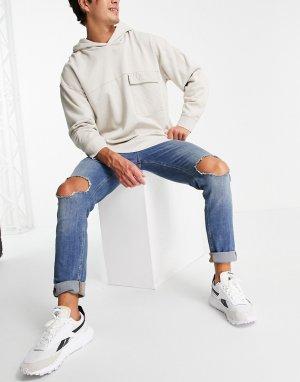 Голубые выбеленные джинсы скинни со рваной отделкой на коленях -Голубой ASOS DESIGN