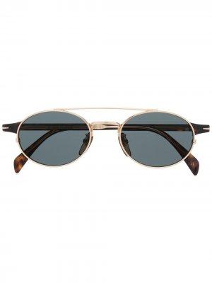 Солнцезащитные очки в овальной оправе Eyewear by David Beckham. Цвет: золотистый