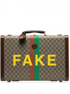 Tan 'Fake/Not monogram print medium suitcase Gucci. Цвет: коричневый