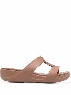 Сандалии Monterey с открытым носком Crocs. Цвет: нейтральные цвета