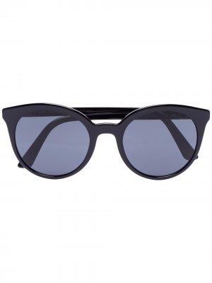 Солнцезащитные очки в круглой оправе с затемненными линзами Prada Eyewear. Цвет: черный