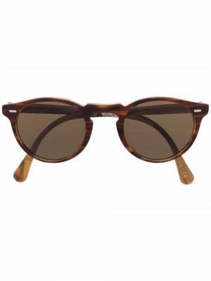 Солнцезащитные очки в круглой оправе Oliver Peoples. Цвет: коричневый