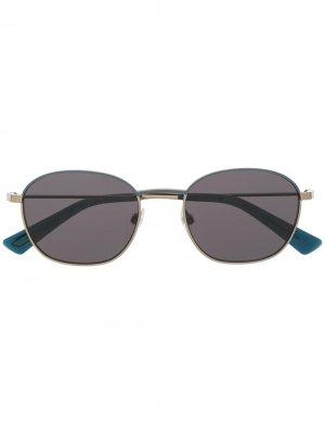 Солнцезащитные очки в круглой оправе с затемненными линзами Diesel. Цвет: синий