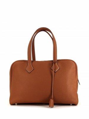 Дорожная сумка Victoria 2019-го года Hermès. Цвет: золотистый