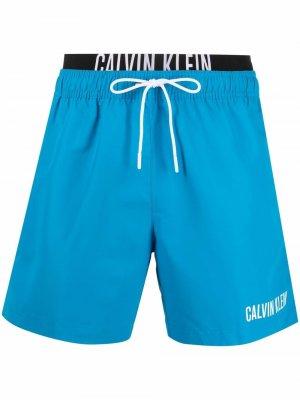 Плавки-шорты с логотипом Calvin Klein Underwear. Цвет: синий