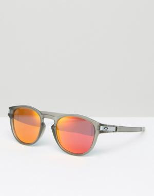 Солнцезащитные очки в круглой оправе Oakley. Цвет: прозрачный