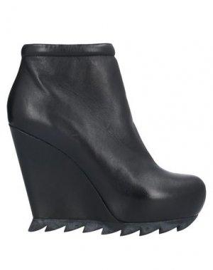 Полусапоги и высокие ботинки CAMILLA SKOVGAARD. Цвет: черный