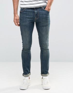 Темно-синие выбеленные джинсы скинни ASOS DESIGN. Цвет: синий