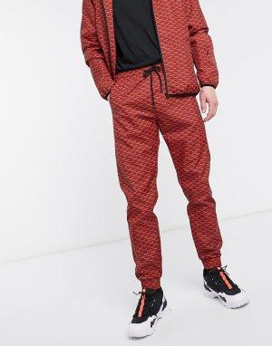 Красные спортивные штаны с узором -Красный Criminal Damage