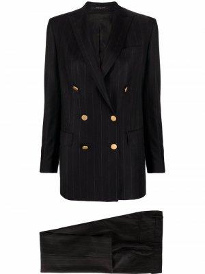 Костюм узкого кроя с двубортным пиджаком Tagliatore. Цвет: черный