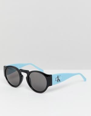 Круглые солнцезащитные очки CKJ18500S-Черный Calvin Klein Jeans
