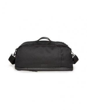 Дорожная сумка EASTPAK. Цвет: черный