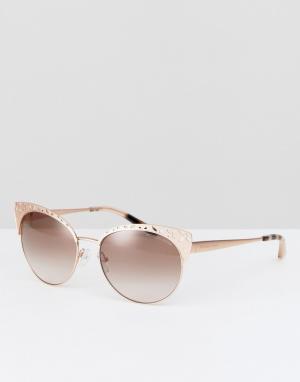 Солнцезащитные очки кошачий глаз в металлической оправе с цветочной от Michael Kors. Цвет: золотой