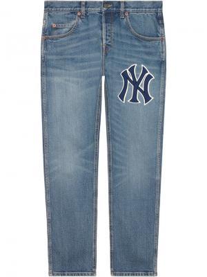 Зауженные джинсы с нашивкой Gucci